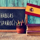 46738484-a-chalkboard-with-the-question-hablas-espanol-do-you-speak-spanish-written-in-spanish-a-pot-with-pen